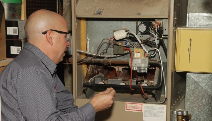 Pdm Technician Repairing Furnace