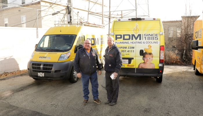Pdm Two Trucks And Staff