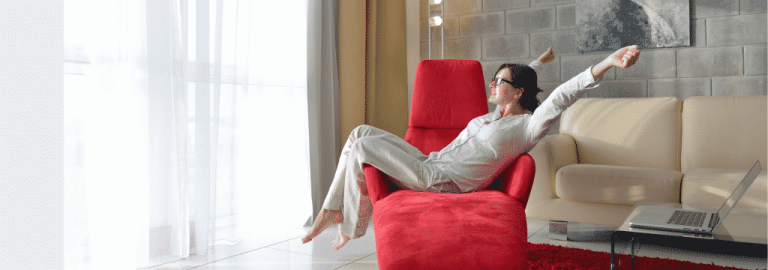 Woman Relaxing On Couch Pdm 1024x360 1